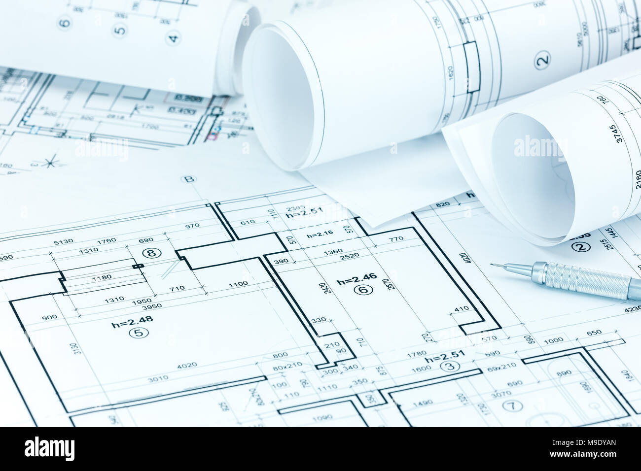 architectural project plans and blueprint rolls pencil on architect