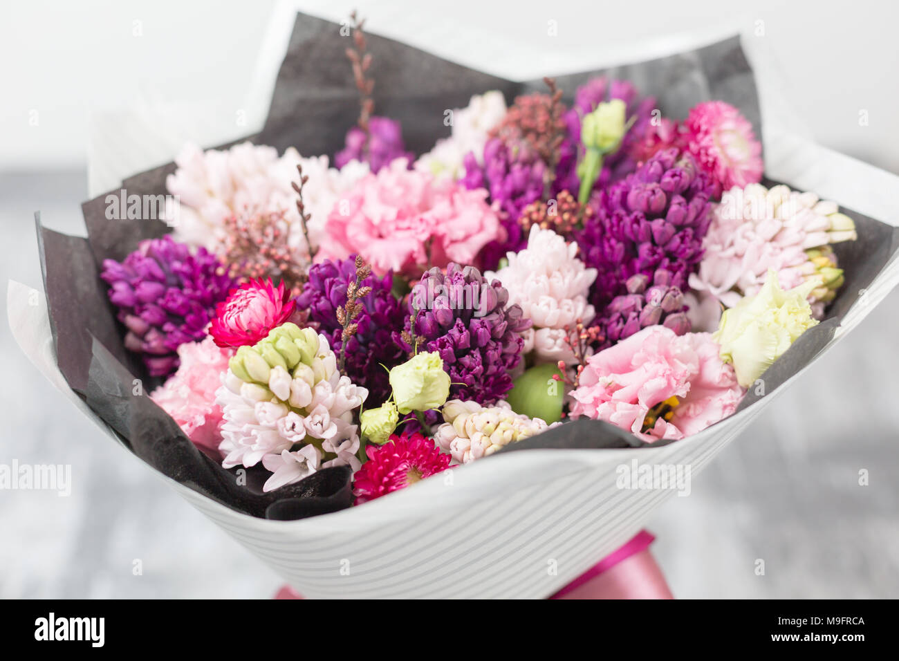 Bouquet of beautiful violet and pink hyacinths spring flowers in bouquet of beautiful violet and pink hyacinths spring flowers in vase on gray table background bulbous plant izmirmasajfo
