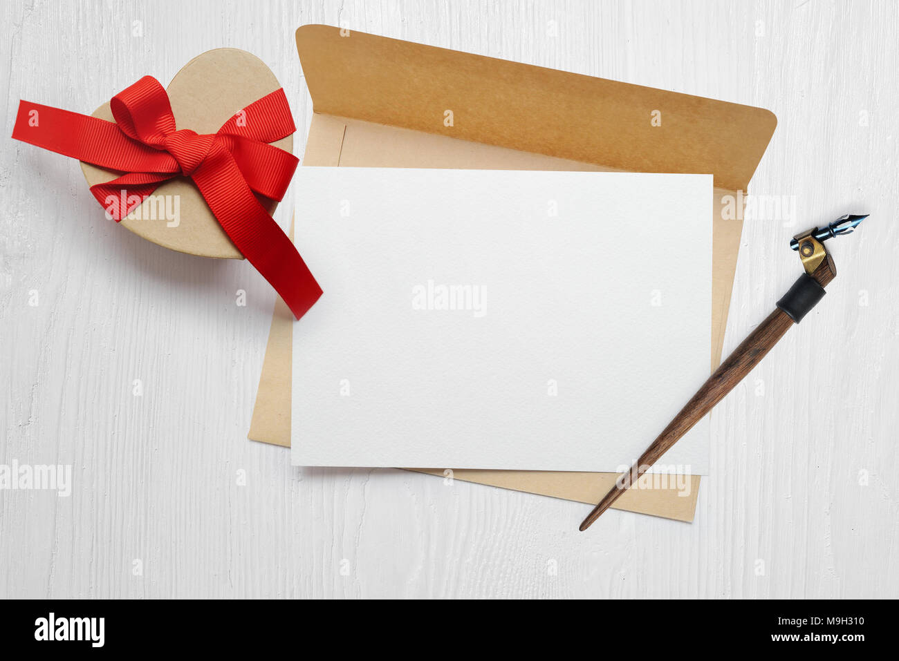 mockup calligraphic feather an envelope with letter and a gift with
