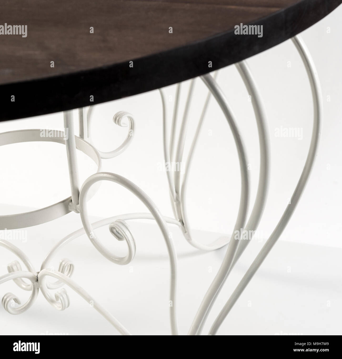 Wrought Iron. Beautiful Curved Ornaments Of Table With Wooden Top