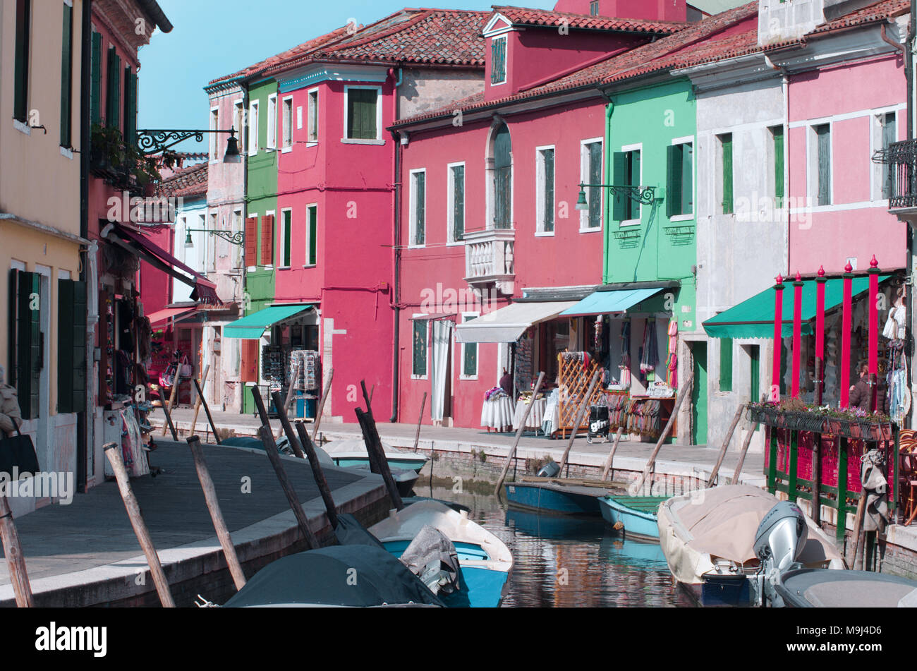 colorful houses overlooking on a small canal in the beautiful island ...
