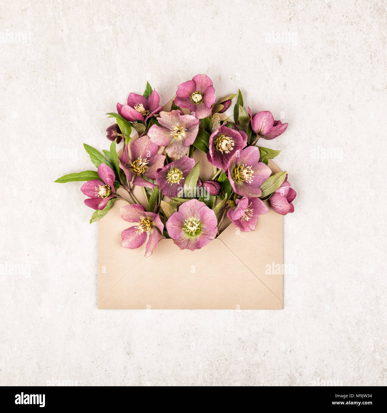 Beige Craft Envelope Full Of Pink And Red Flowers And Green Leaves