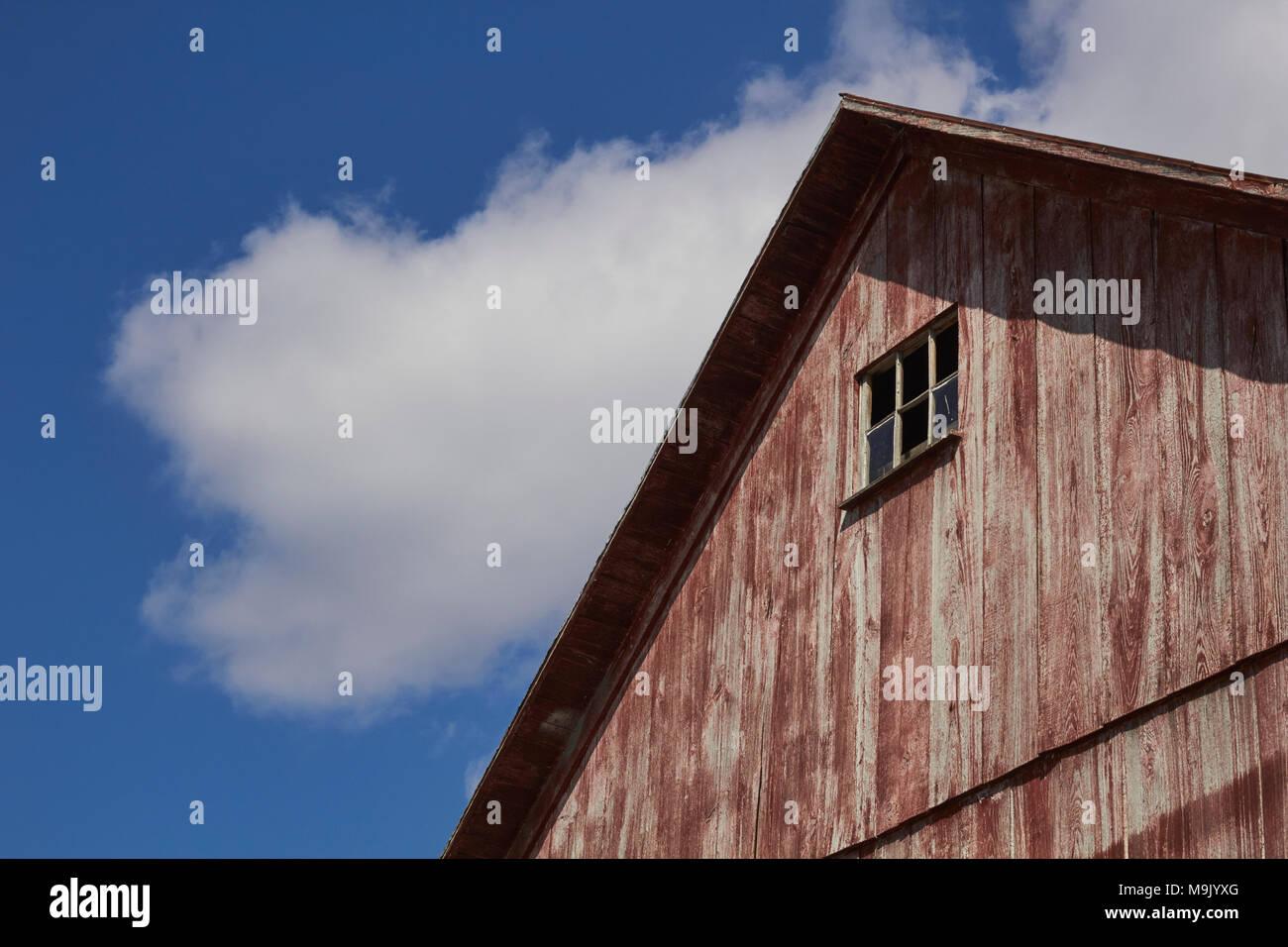 Pennsylvania dutch barn stock photos pennsylvania dutch barn a weathered red wooden barn against a blue sky lancaster county pennsylvania usa biocorpaavc Images