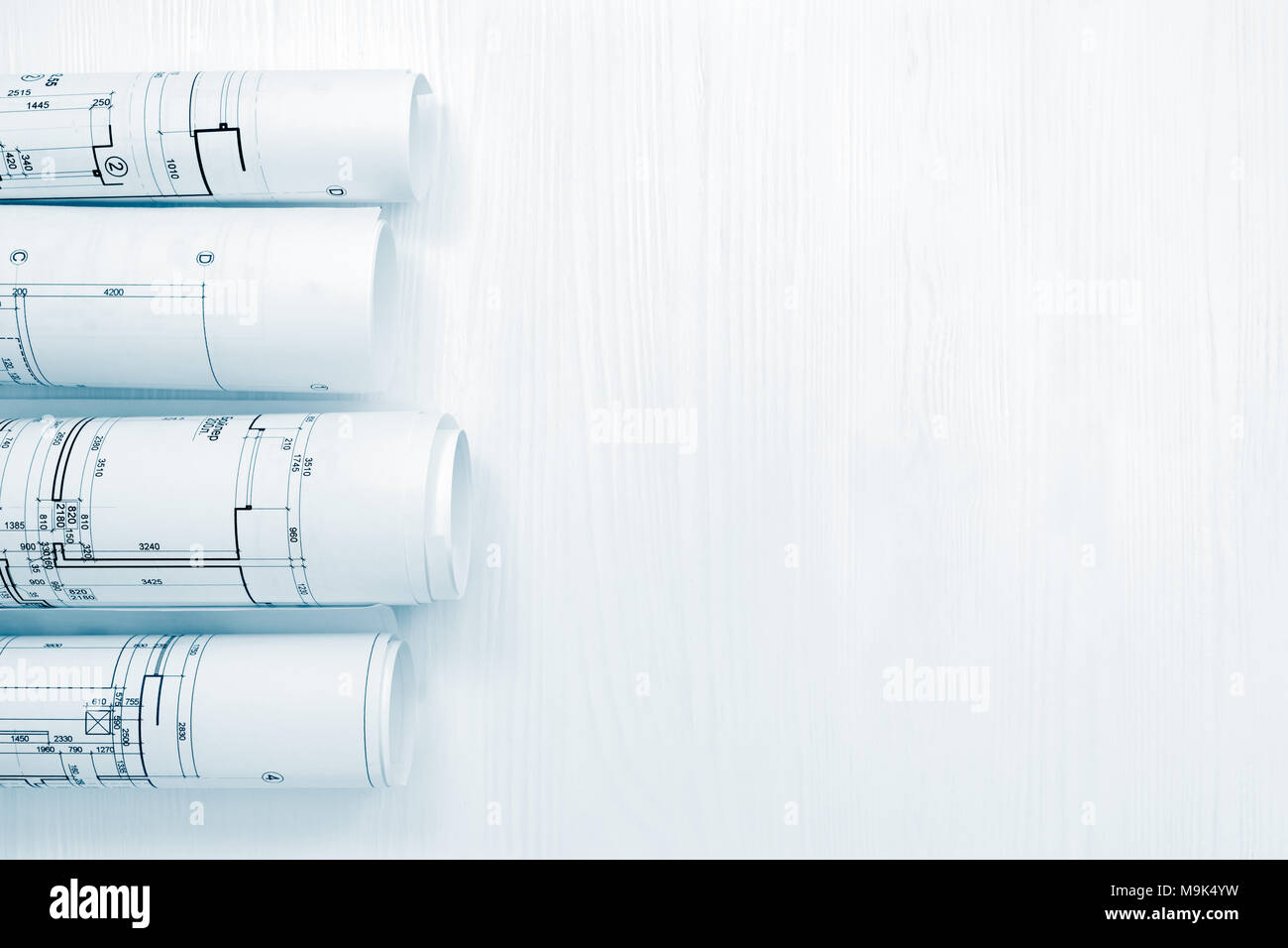 Architectural background with blueprint rolls and technical drawings architectural background with blueprint rolls and technical drawings flat view malvernweather Gallery
