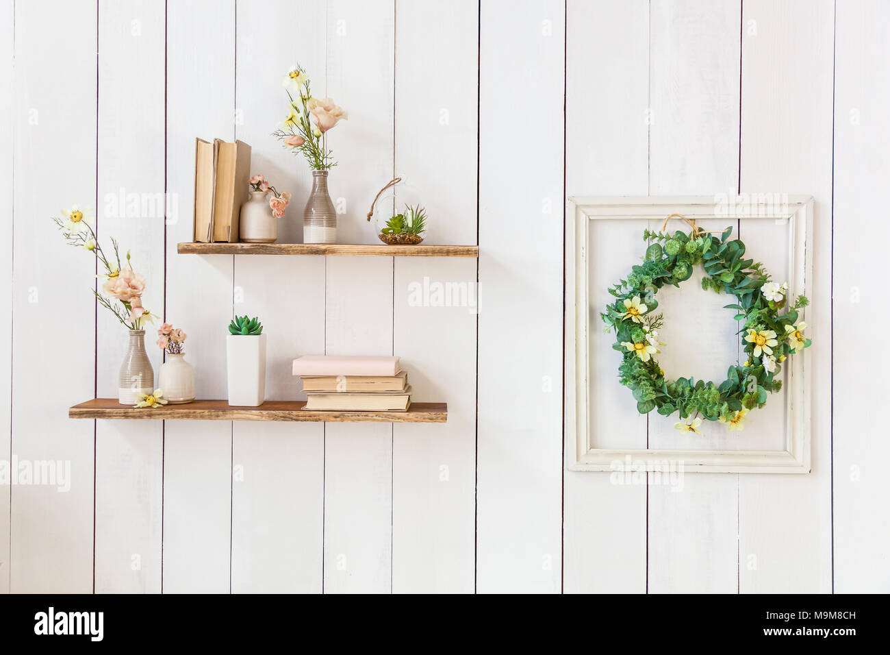 Old books and flowers in a vase on a wooden shelf, frame with ...