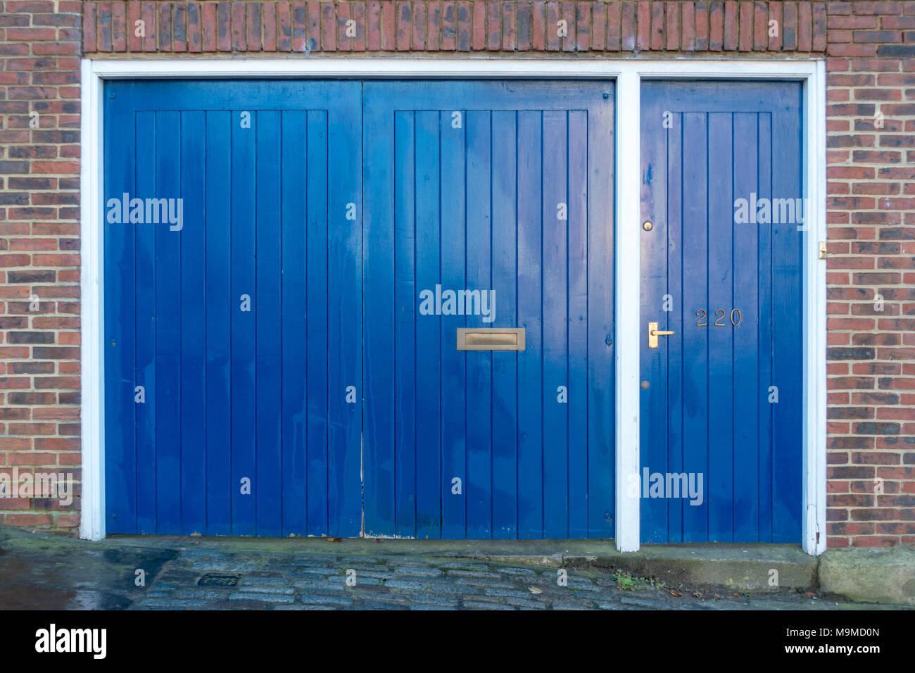 Blue Garage Doors In A Brick Building Stock Photo 178084837 Alamy