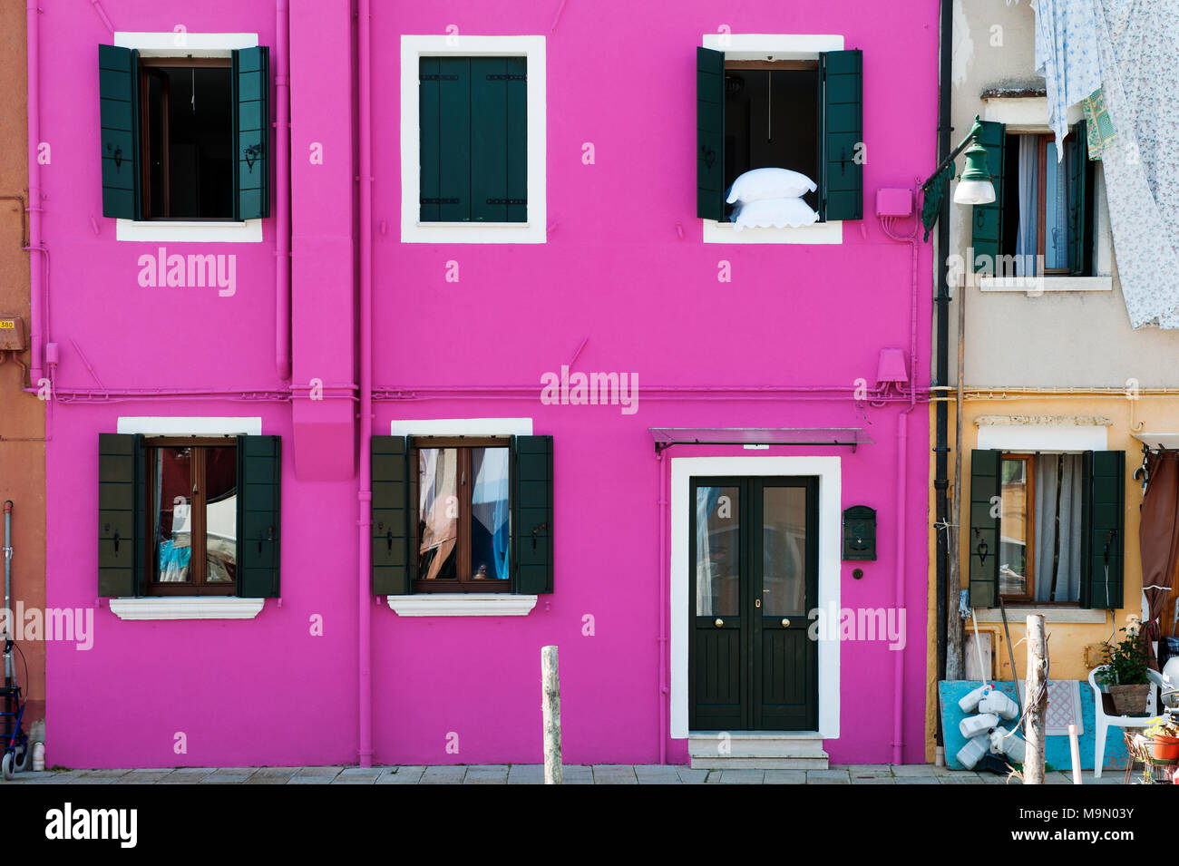 House facade color purple in Burano, a cozy island in Venetian ...