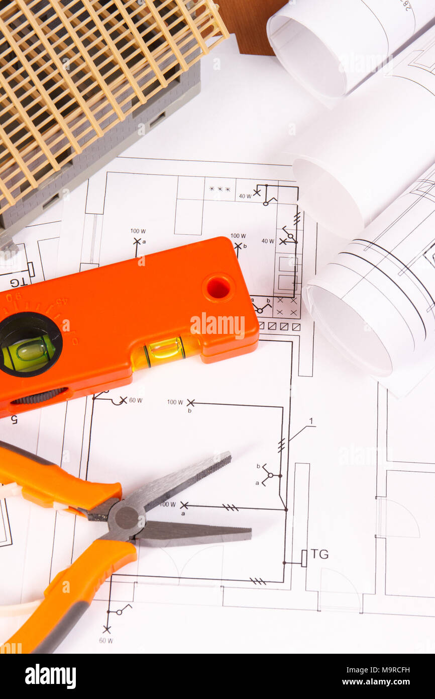 Electrical drawings or diagrams, orange work tools and house under ...