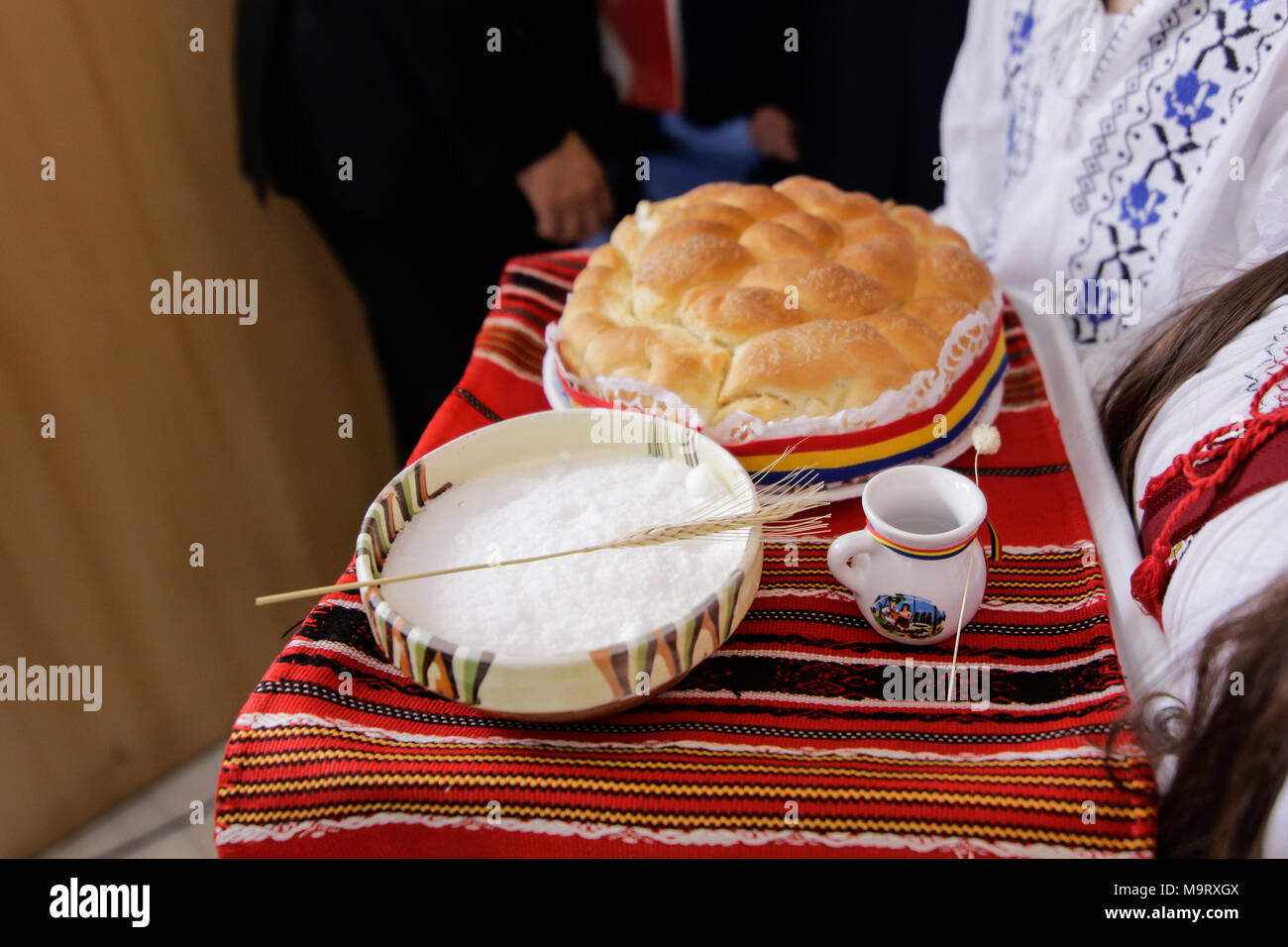 Symbol for welcome stock photos symbol for welcome stock images two young girls dressed in romanian traditional peasant clothing greet officials with the also traditional bread biocorpaavc Gallery