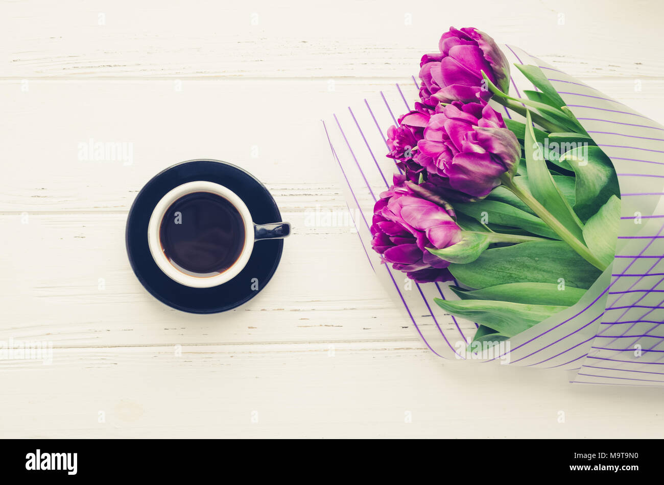 Cup Of Morning Coffee And Bouquet Of Spring Flowers Tulips Over