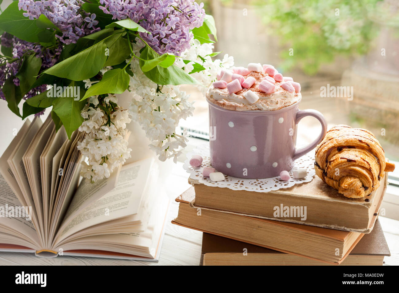 Coffee cup with marshmallow, open book, glasses, croissant and ...