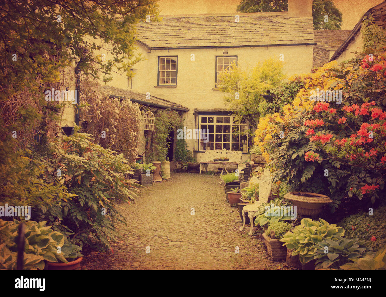 Garden at the front of old house, Lake District, Cumbria, UK. Photo ...