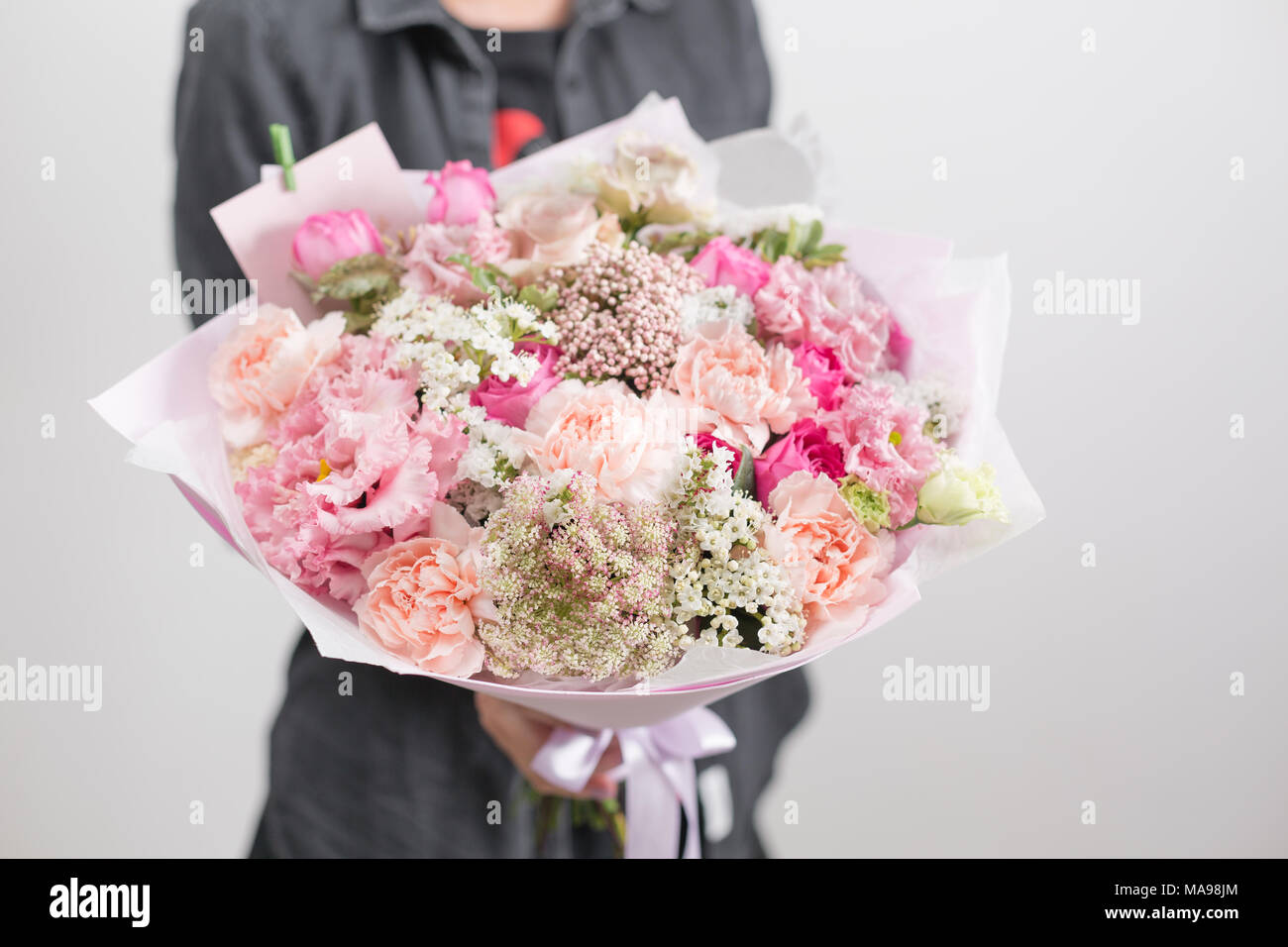 Beautiful luxury bouquet of mixed flowers in woman hand the work of beautiful luxury bouquet of mixed flowers in woman hand the work of the florist at a flower shop a small family business izmirmasajfo