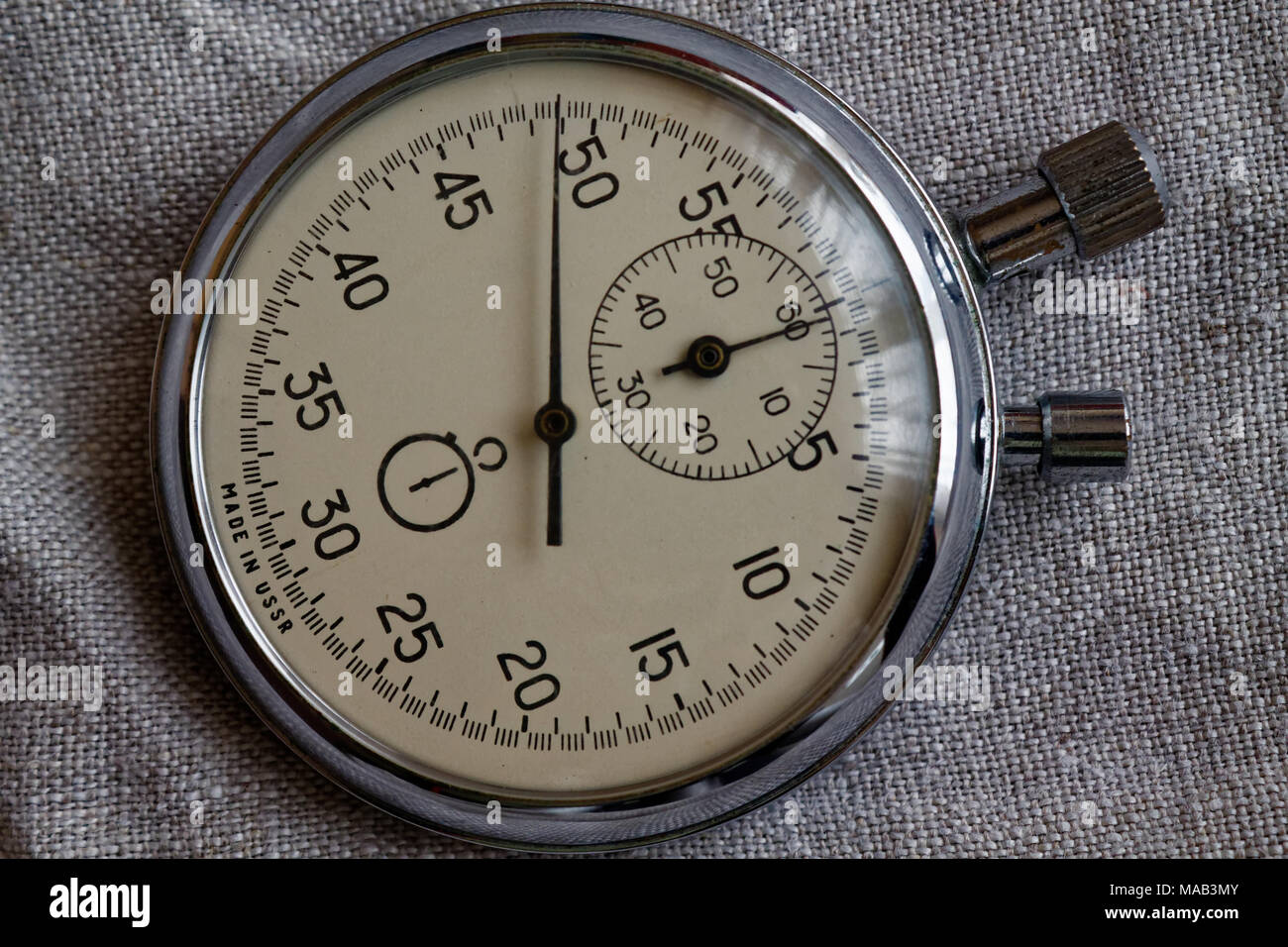 stopwatch on canvas background value measure time old clock arrow