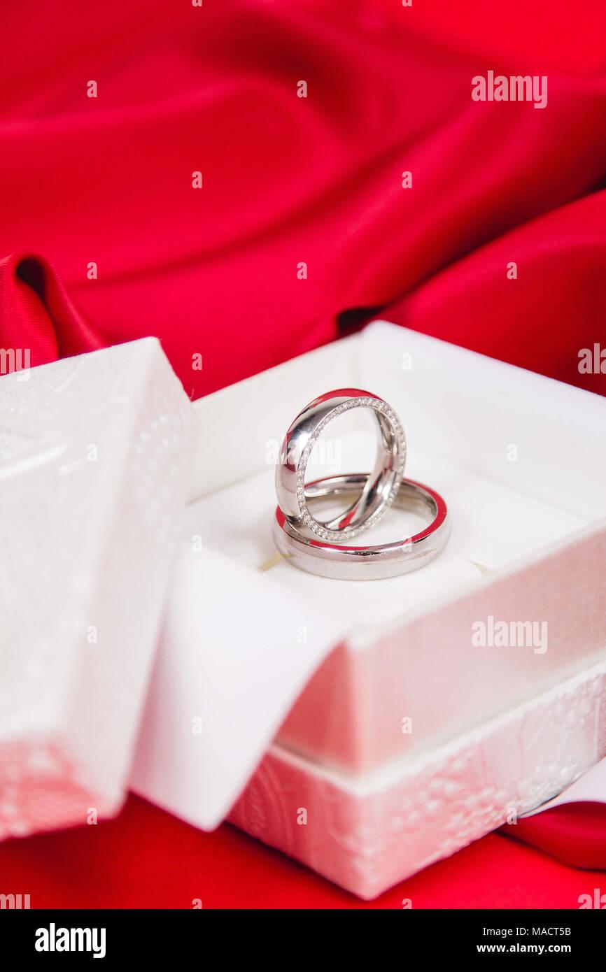 Beautiful wedding rings in white luxury box on red silk Stock Photo ...