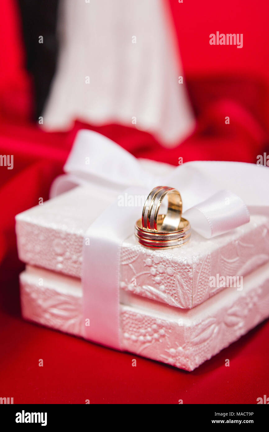 Beautiful wedding rings in white luxury box on red silk Stock Photo ...