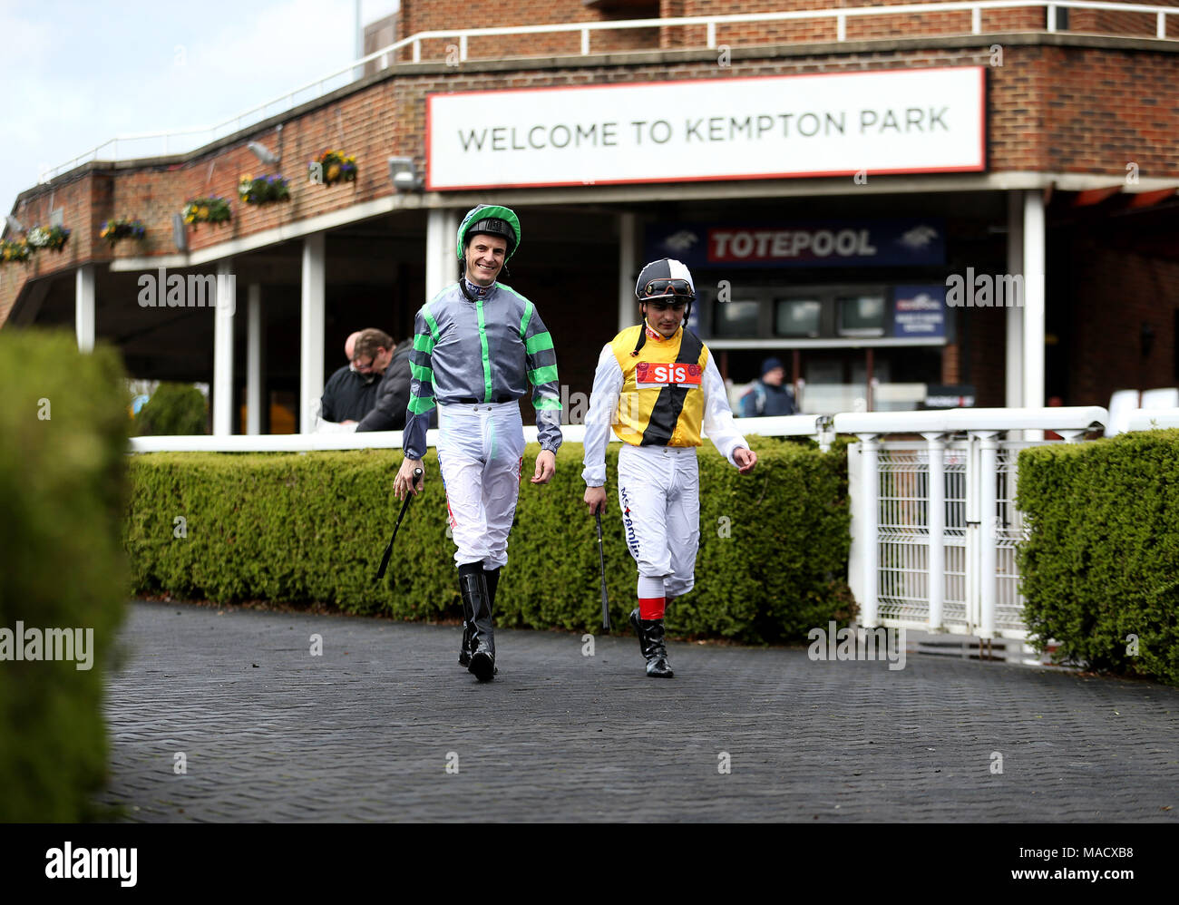 Jockeys parade ring stock photos jockeys parade ring stock general view of jockeys fran berry and andrea atzeni walking into the parade ring before the negle Gallery