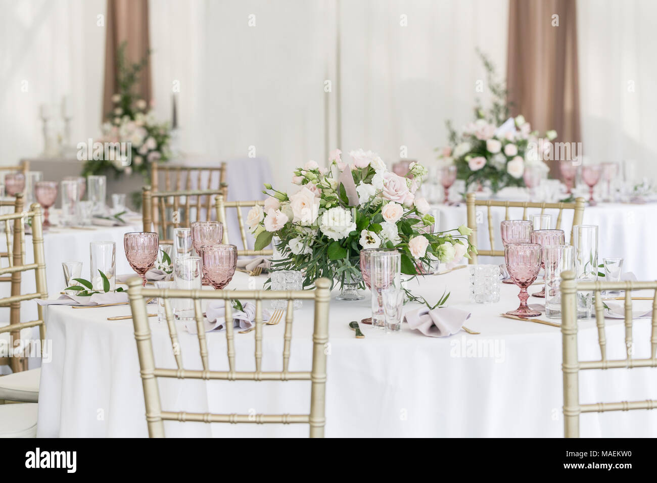 Beautiful Table Setting With Crockery And Flowers For A Party