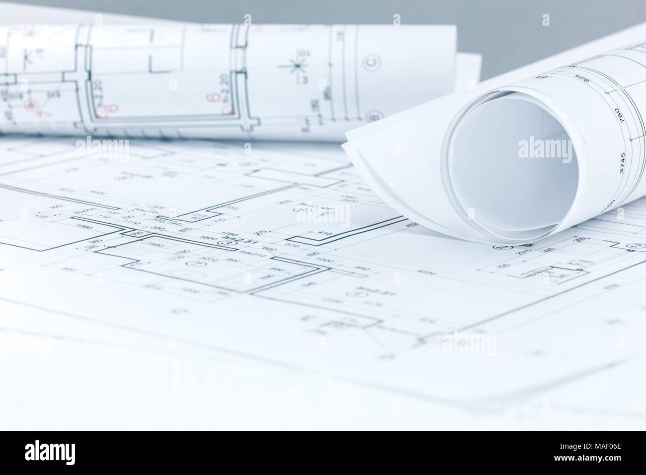 architectural and engineering project plans and blueprint rolls on