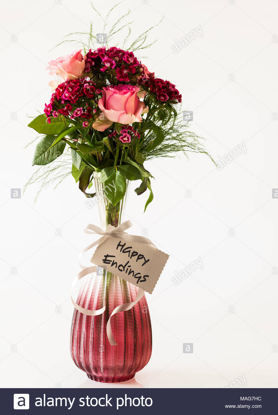 flowers in an elegant vase with the wording happy endings on the