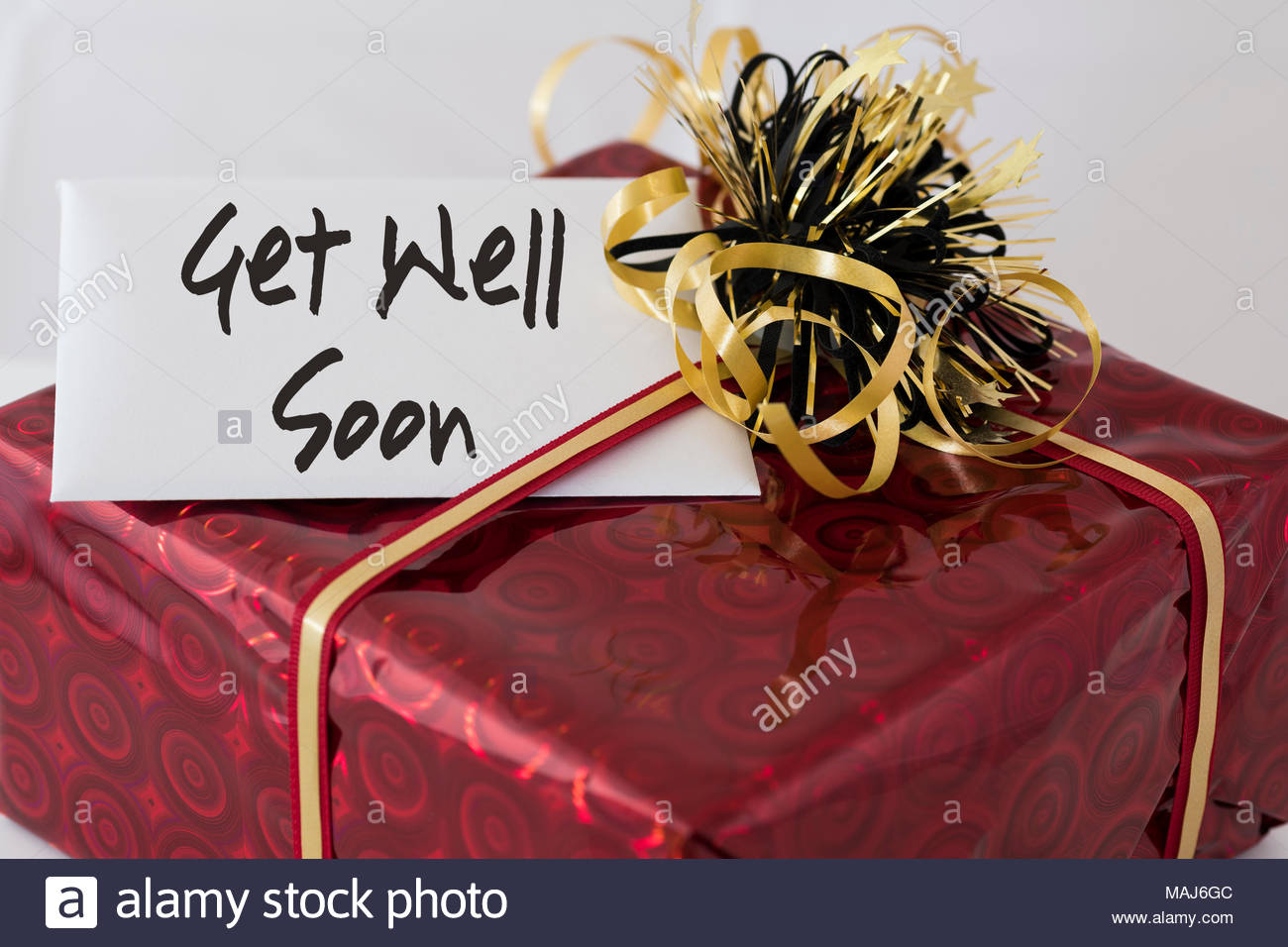 Wrapped Present With The Wording Get Well Soon Written On The Gift