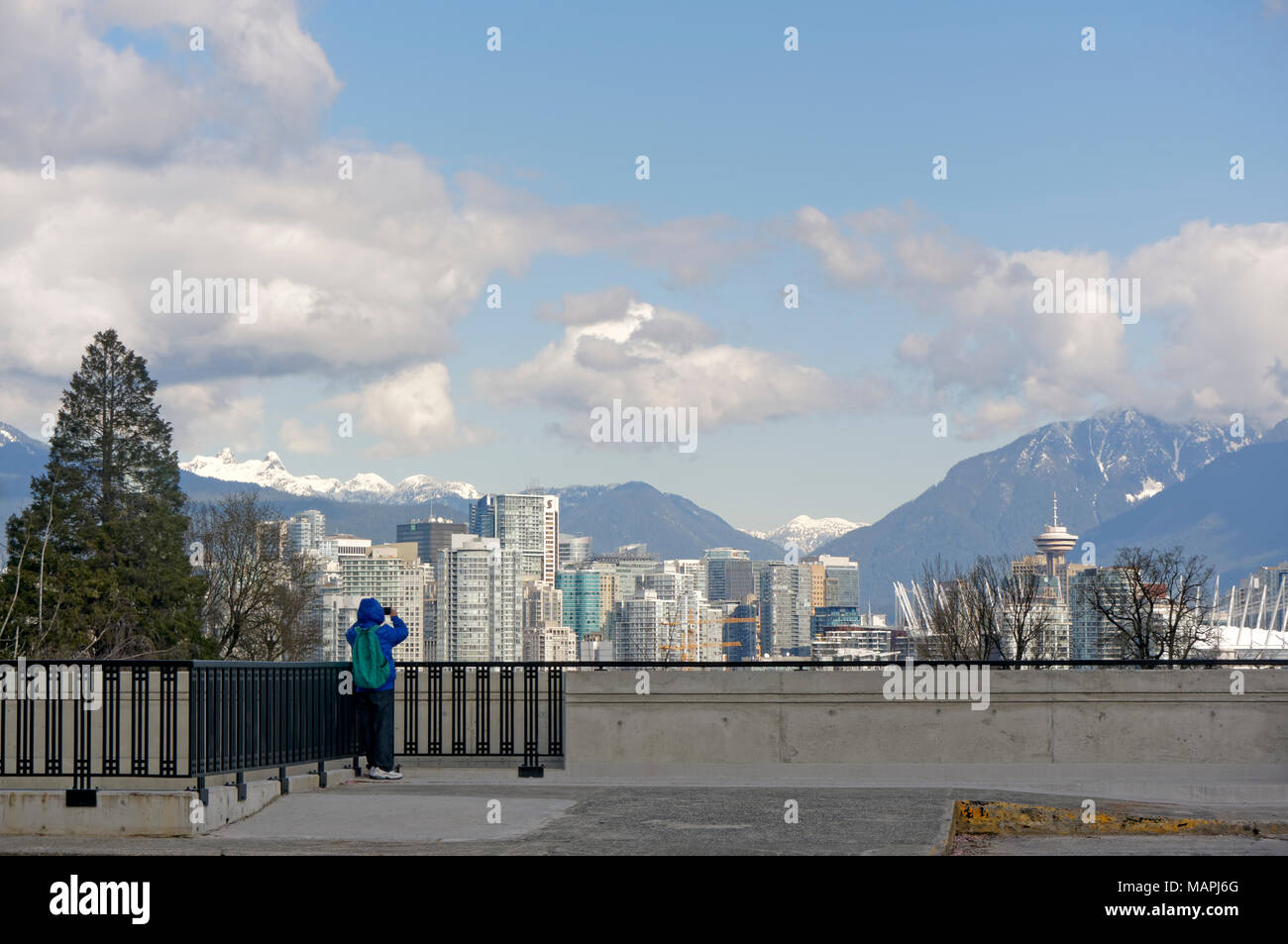 man-photographing-the-vancouver-city-sky