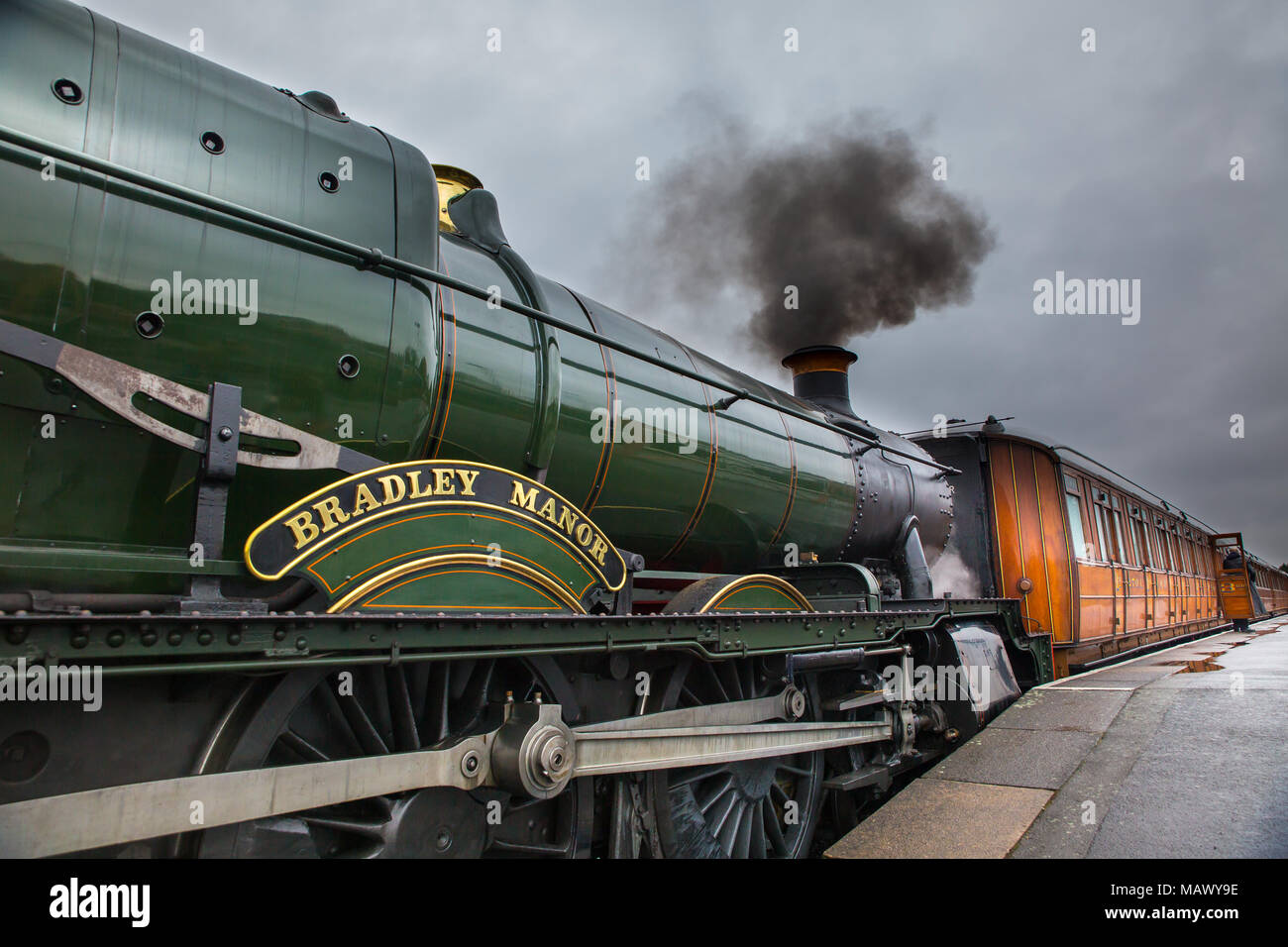 Severn Valley Railway steam locomotive Bradley Manor No.7802 with its rake  of varnished teak carriages awaiting departure at Kidderminster station.