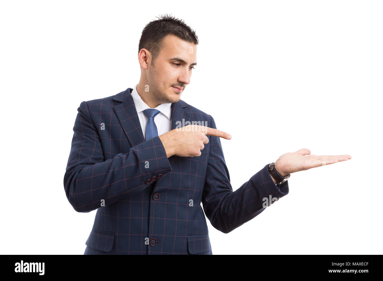 young handsome salesman or businessman pointing and holding option