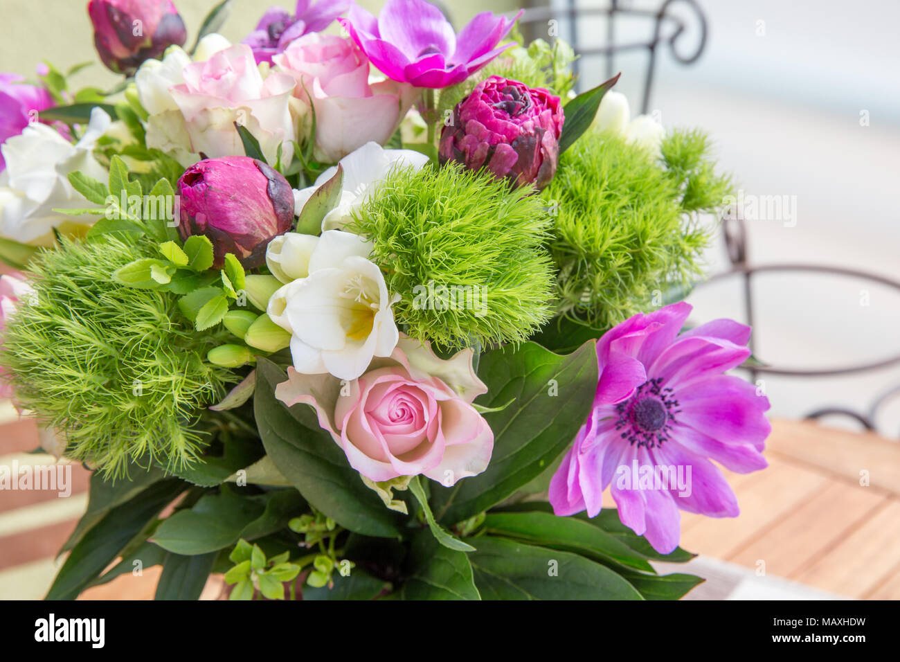 Large beautiful pink bouquet of peonies, roses, anemones in a vase ...