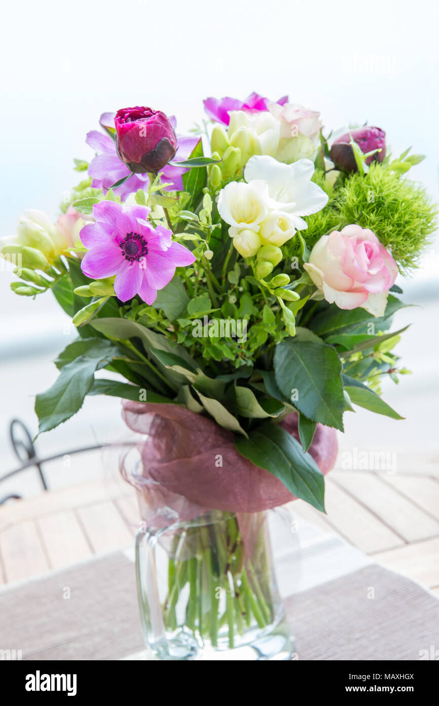 Large beautiful pink bouquet of peonies roses anemones white large beautiful pink bouquet of peonies roses anemones white freesia in a vase on wooden table spring flowers concept mightylinksfo