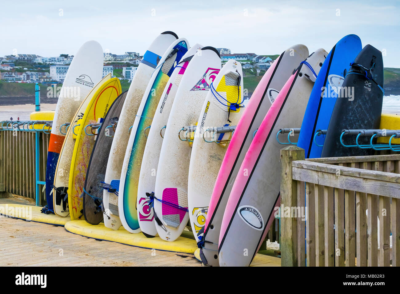 Surfboards Stacked In A Storage Rack At Fistral Beach At Newquay In  Cornwall.