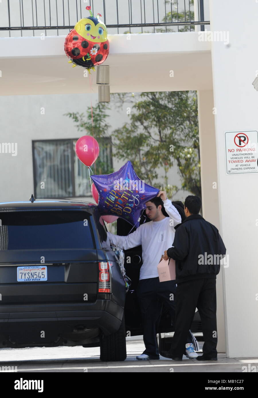 Madison Beer Holding A Handful Of Balloons Roses And Huge Birthday Card For Her 19th Featuring Zack Bia Where Los Angeles California