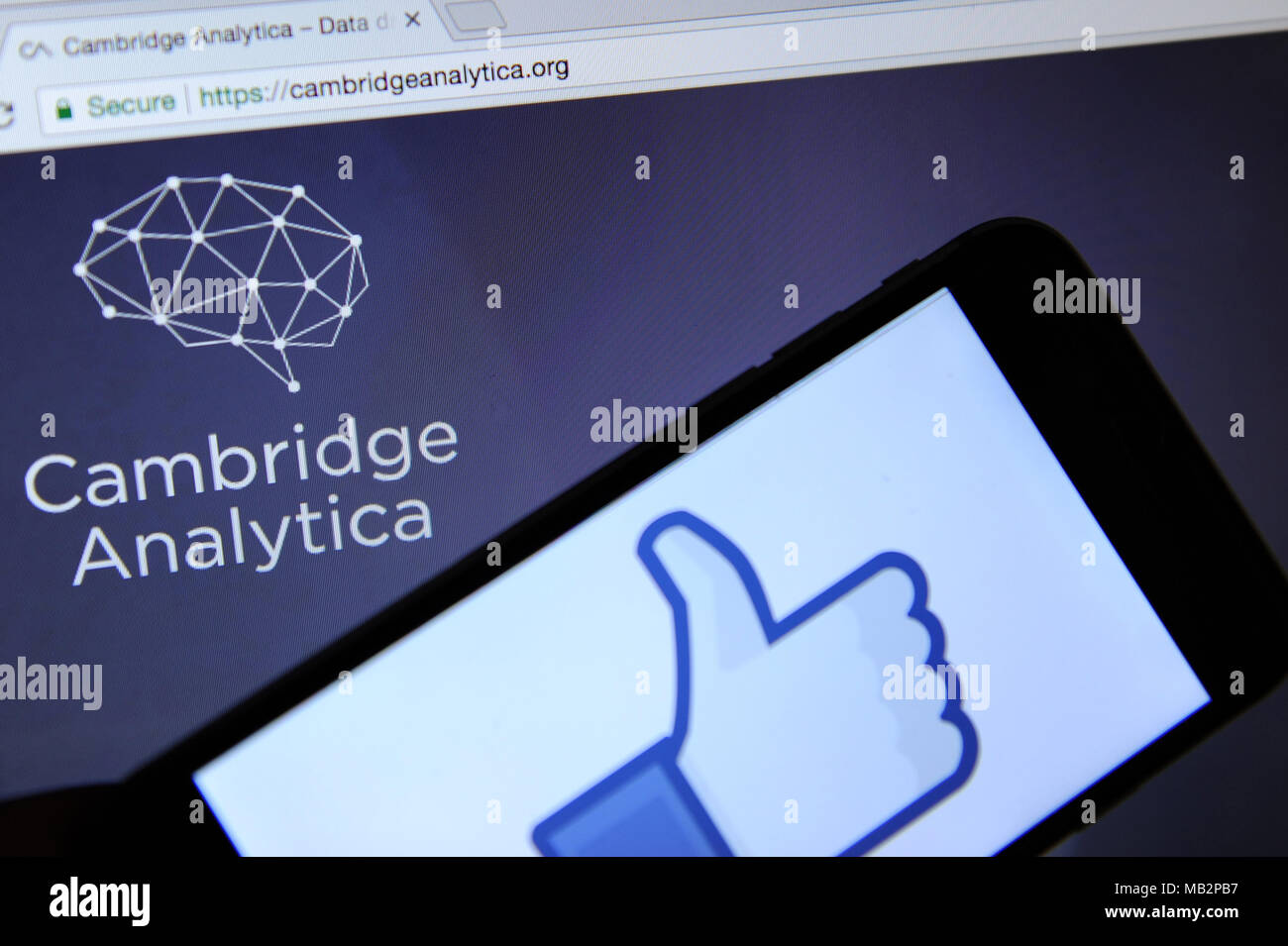 Cambride Analytica Website On A Computer Screen And The Facebook