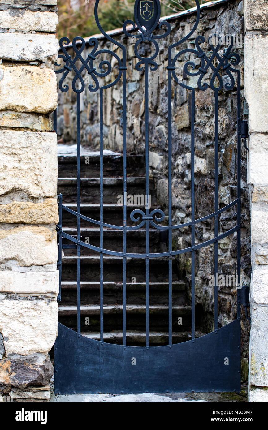 Stone Wall Entrance To A Garden, Security Closed Entrance Door.