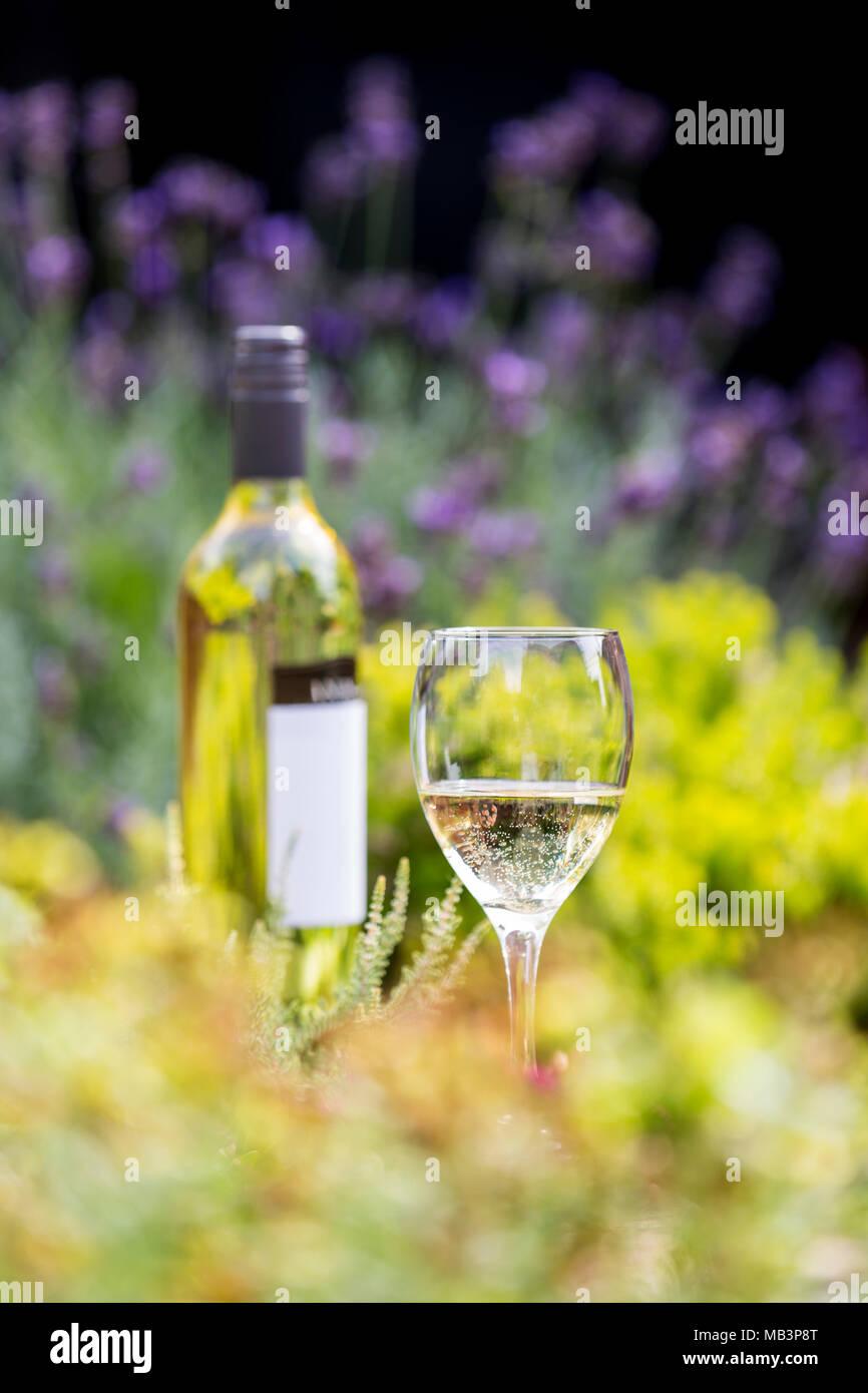 White wine in glass with bottle amongst flowers stock photo white wine in glass with bottle amongst flowers mightylinksfo