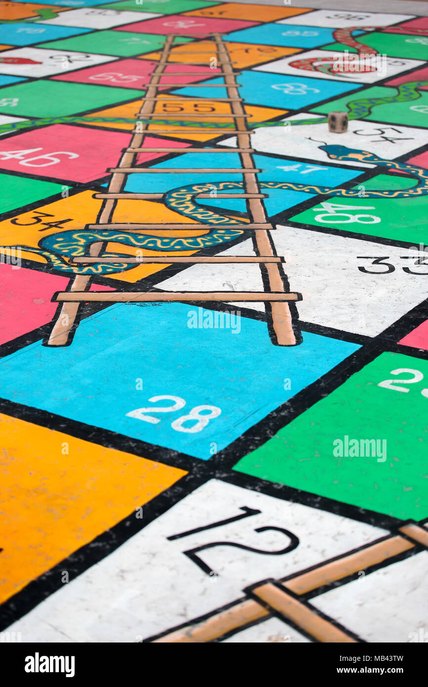 Snake And Ladder Board Game Painted On The Floor Stock Photo
