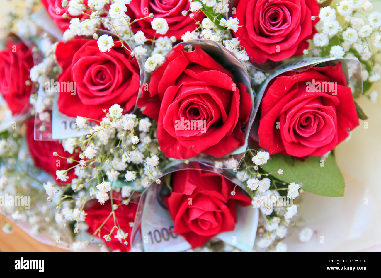 Red rose bouquet with money wrapping rose stock photo 178988395 alamy red rose bouquet with money wrapping rose izmirmasajfo