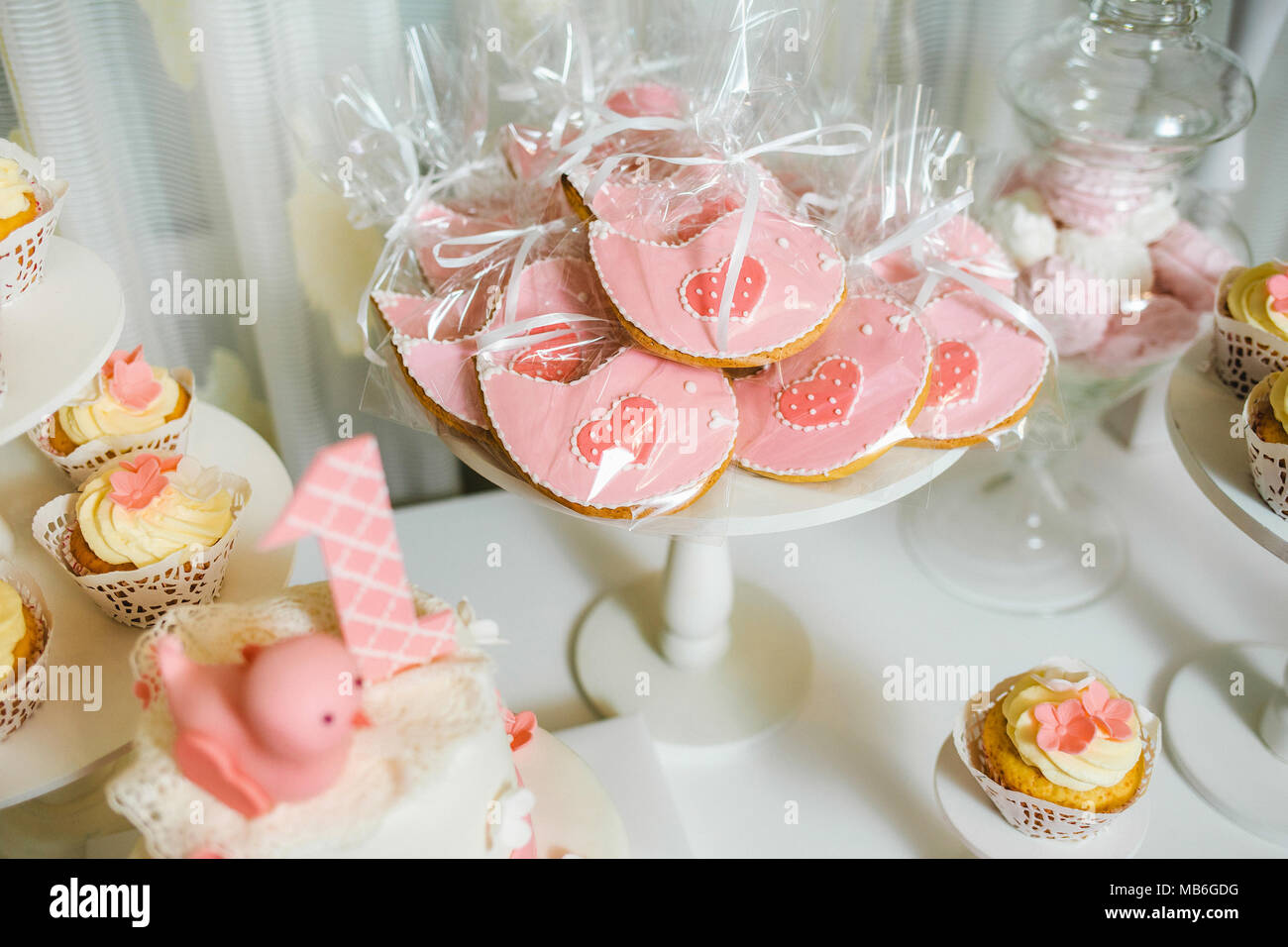 Catering for birthday party. Closeup of sweet cute pink desserts ...