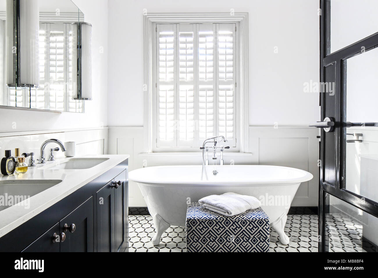 Bathroom with tiled floor and old fashioned bathtub. Private ...