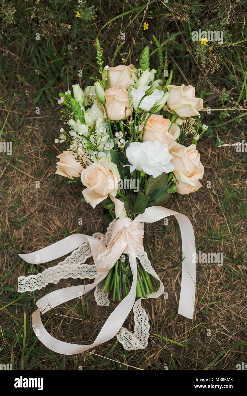 Bouquet of bridal wedding flowers on ground in wood rustic style of bouquet of bridal wedding flowers on ground in wood rustic style of elements of decor top view vertical color photo izmirmasajfo