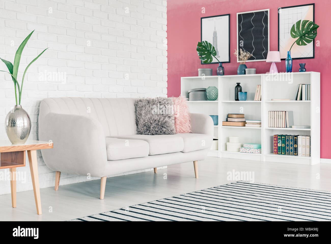 brick living room furniture. k white sofa in pink living room interior with white brick wall striped rug  posters and bookcase books decorations