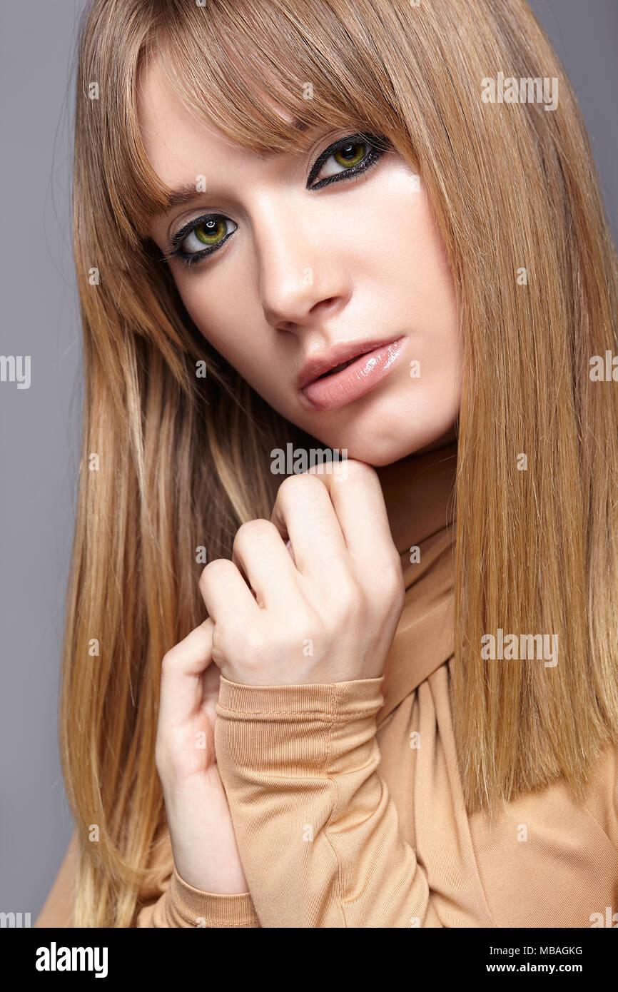 long blonde hair green eyes