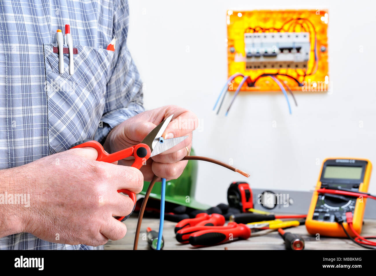 Electrician Technician At Work In A Residential Electric Wiring Installation Cuts The Cable
