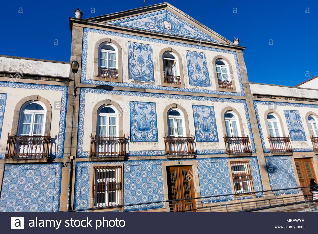 blue and white tiles cover the facade of houses in Aveiro Portugal ...