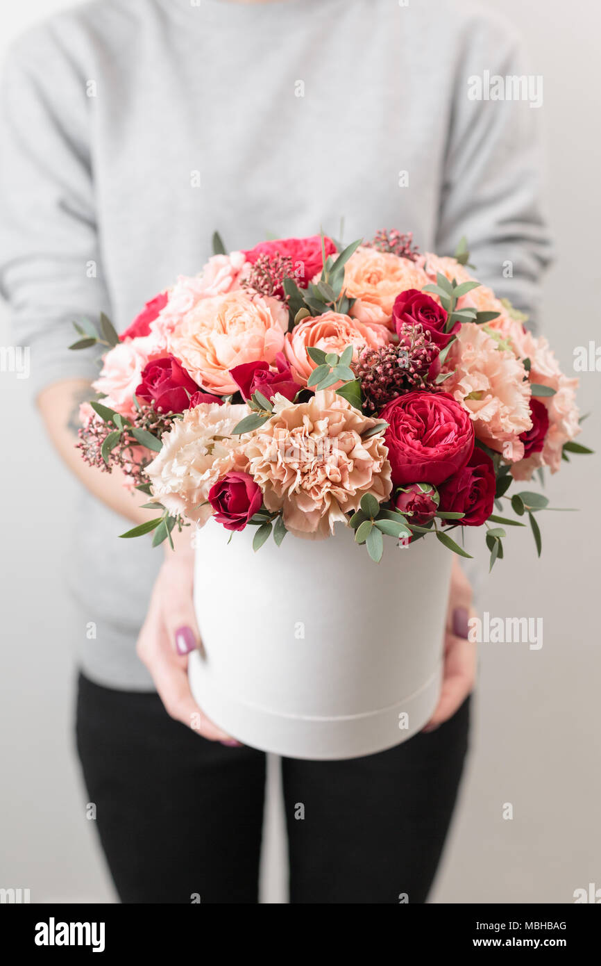 Beautiful luxury bouquet of mixed flowers in woman hand the work of beautiful luxury bouquet of mixed flowers in woman hand the work of the florist at a flower shop vertical photo izmirmasajfo