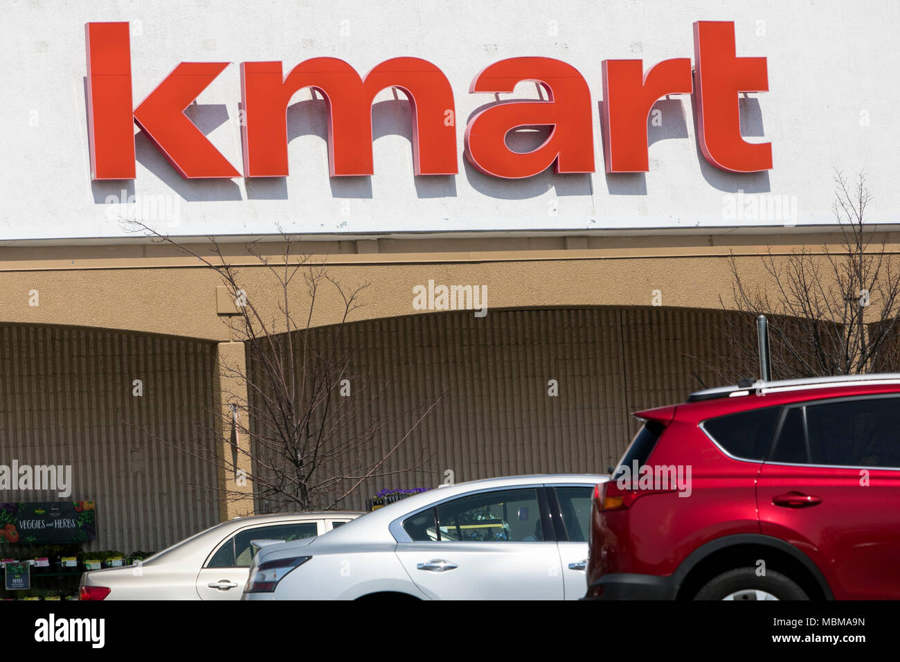 A logo sign outside of a Kmart retail store location in Silver ...