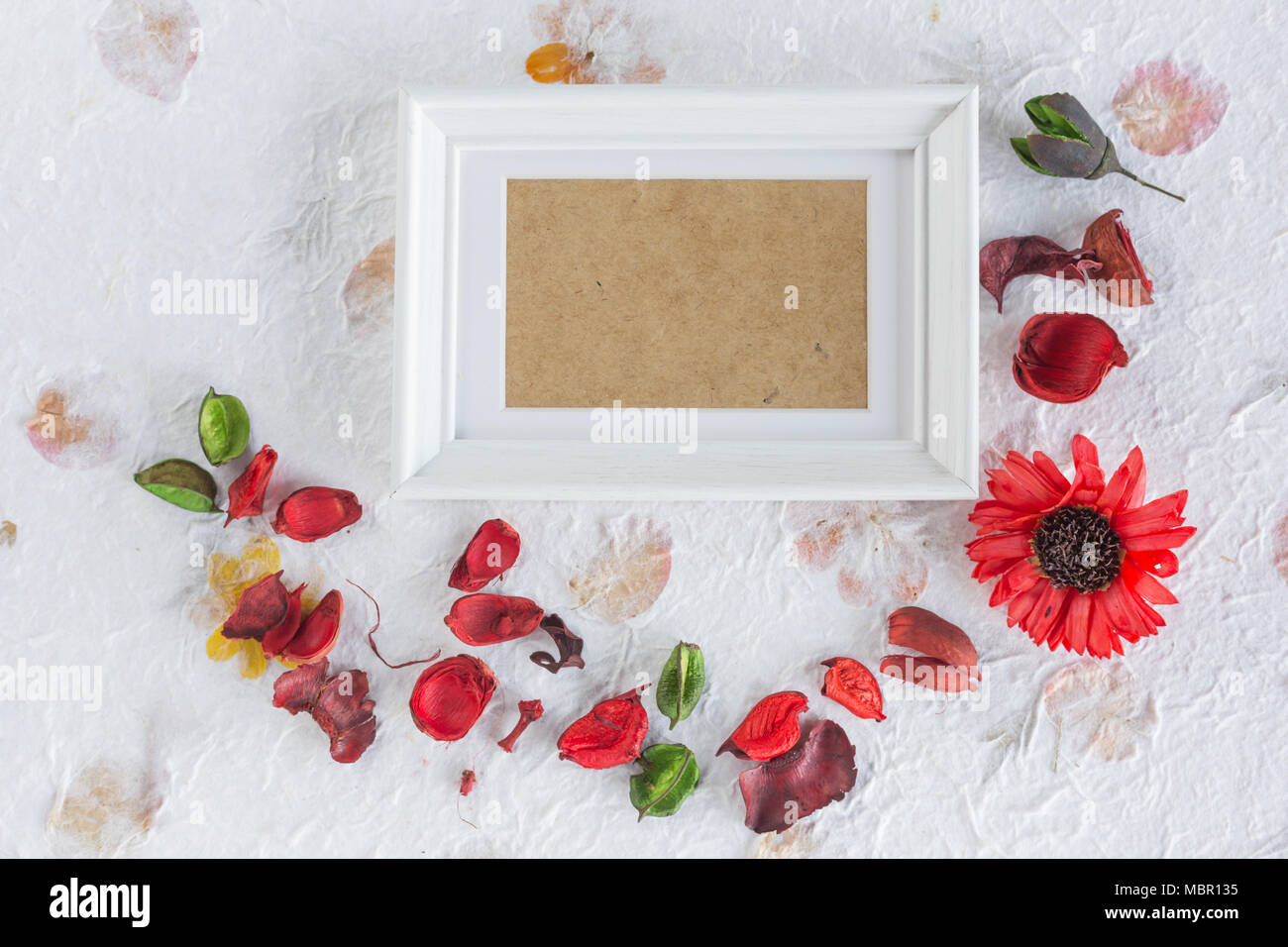 Wooden frame with dried flower arrangement on diy paper Stock Photo ...