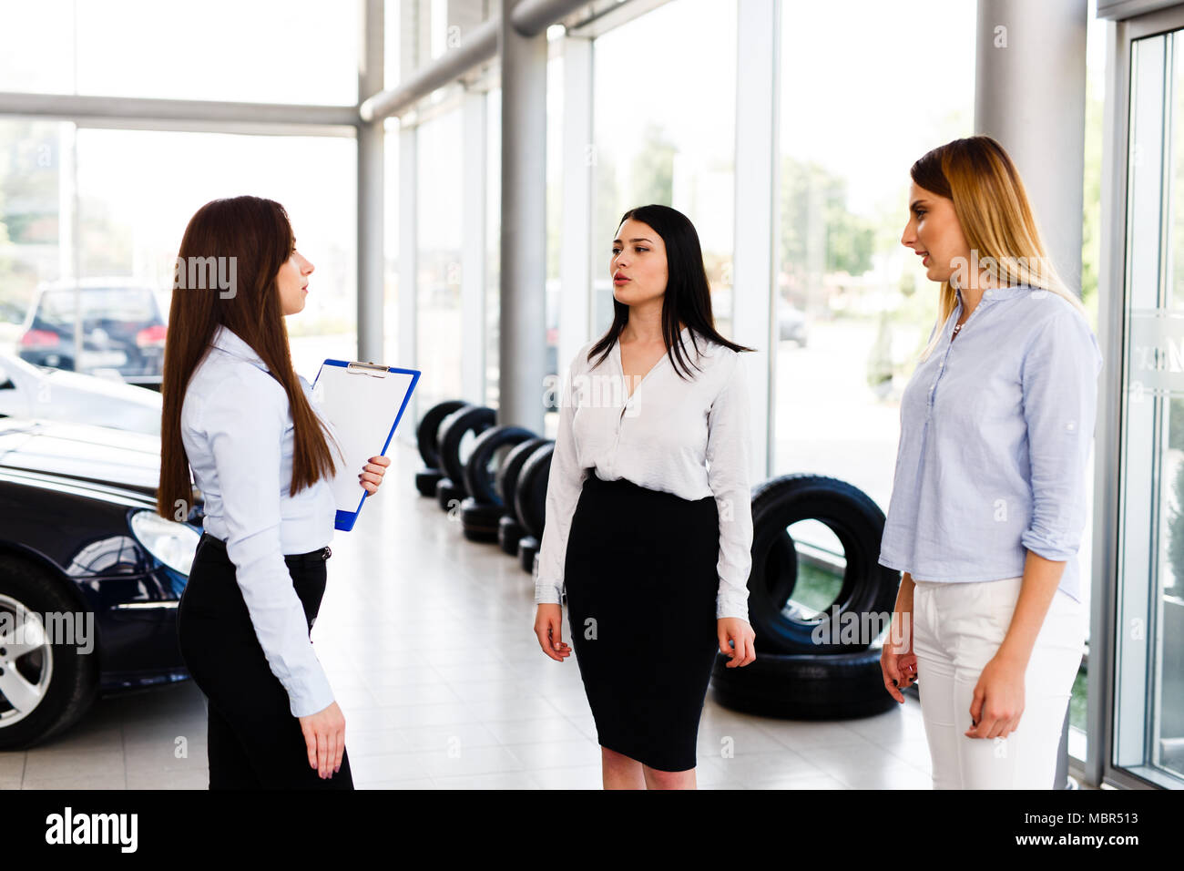 Three Business Womens Standing And Making A Agreement In Modern Car