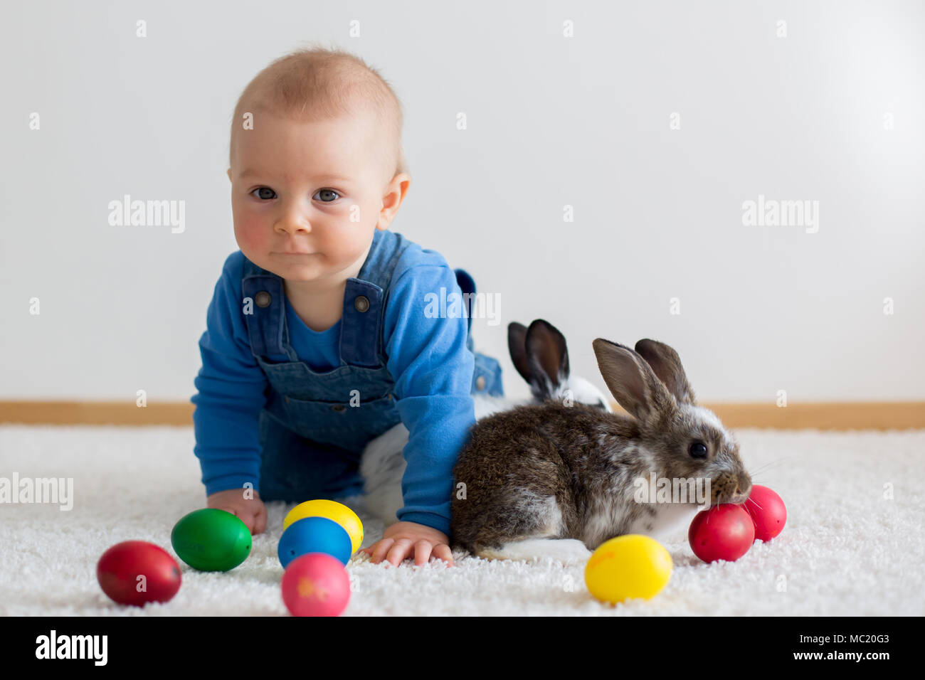 Little Toddler Child Baby Boy Playing With Bunnies And Easter Eggs At Home Colorful Hand Drawings On The