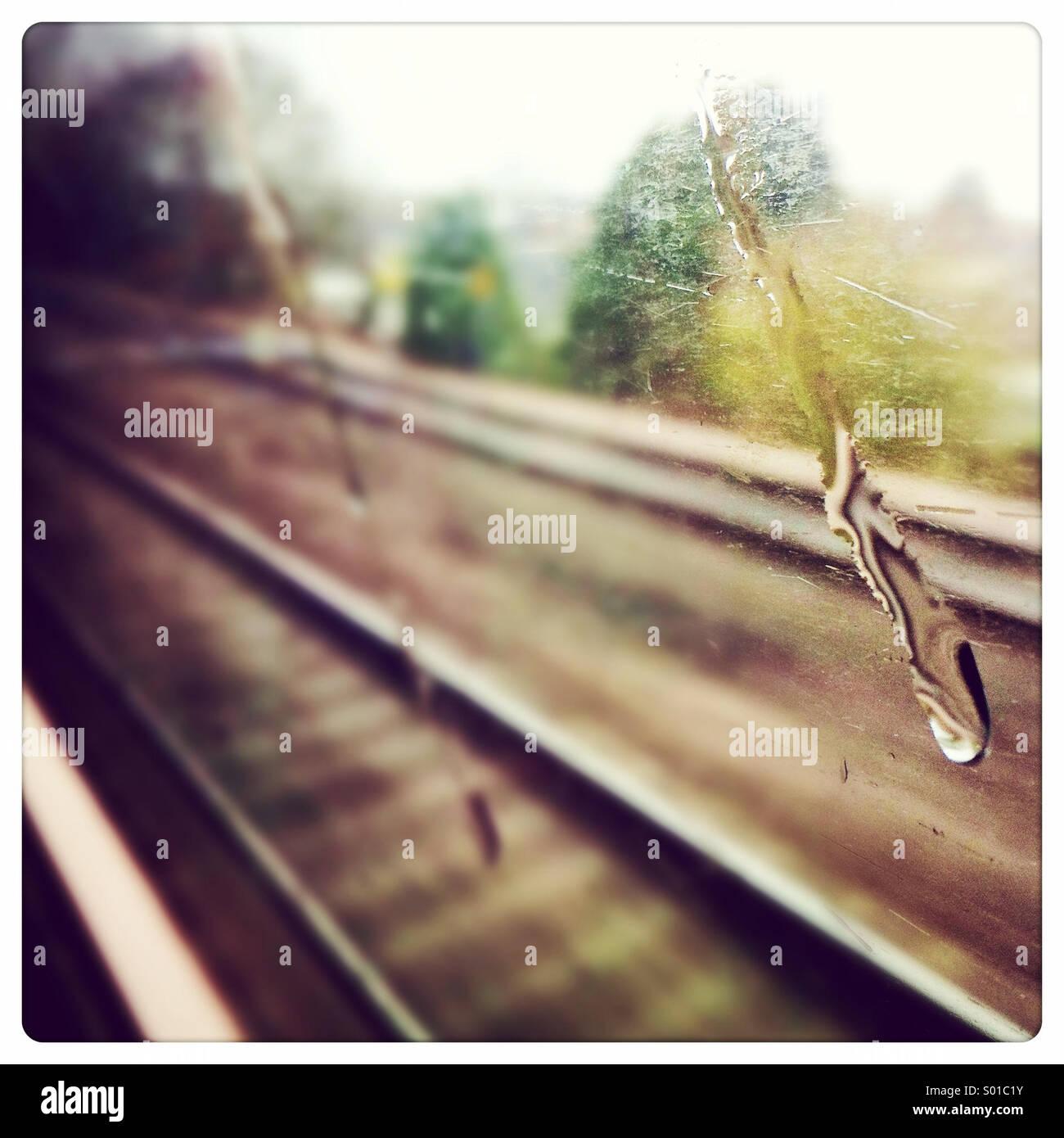drop-of-water-running-down-a-train-windo